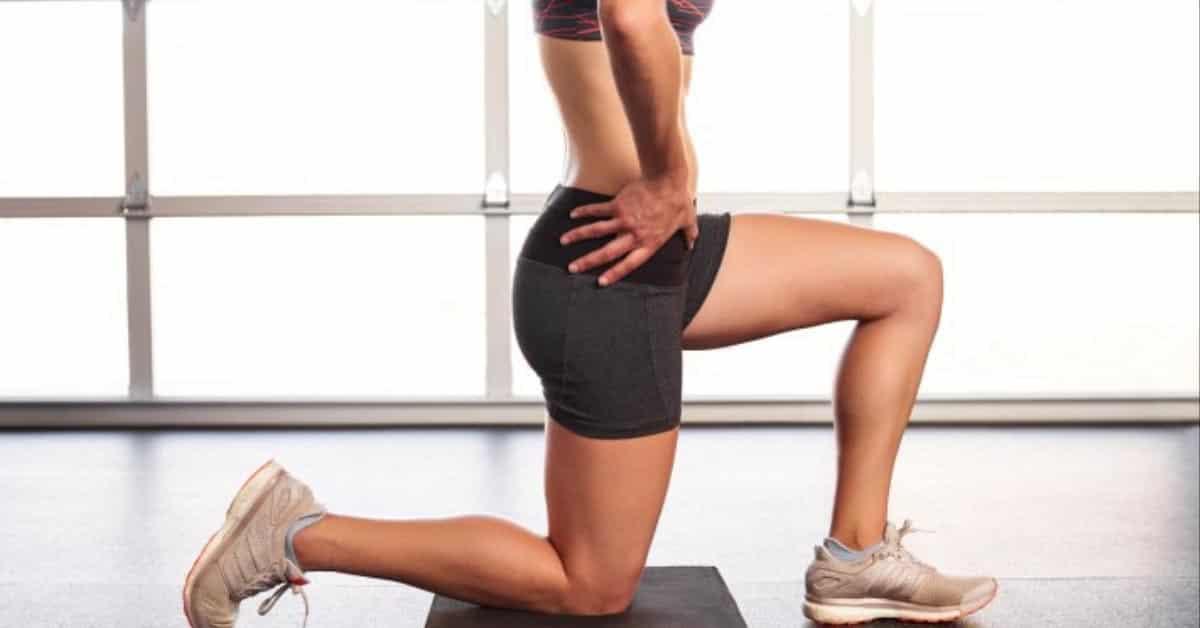 Woman doing kneeling hip flexor stretch on foam kneepad