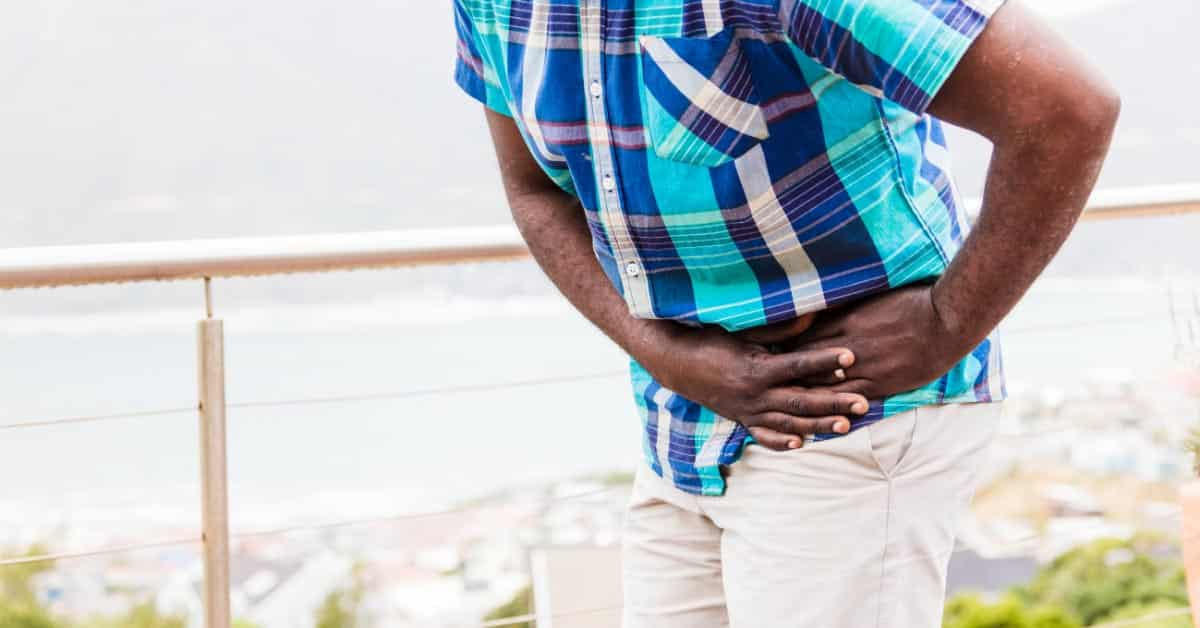 What causes hip pain when standing up after sitting?
